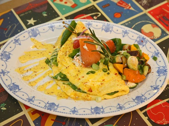 Omelets at Sabrosa include the smoked salmon, also stuffed with spinach and mozzarella. It's served with potato-vegetable hash.