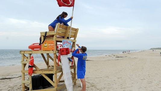 The beach at Cape Henlopen State Park was open Tuesday morning but the no-swimming flag was posted, a day after a teenager was bitten by a shark.