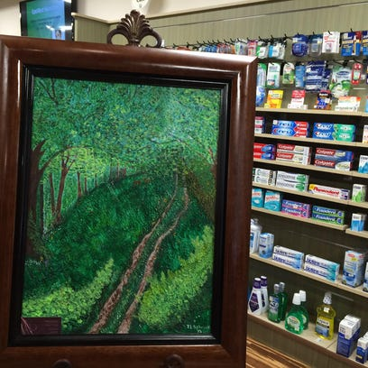 Tammy Schrock painting at the OptiMed pharmacy