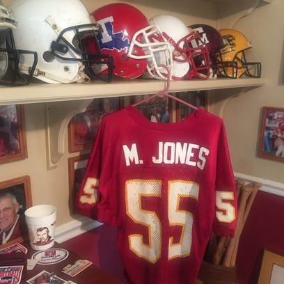A Marvin Jones jersey hangs from a shelf.