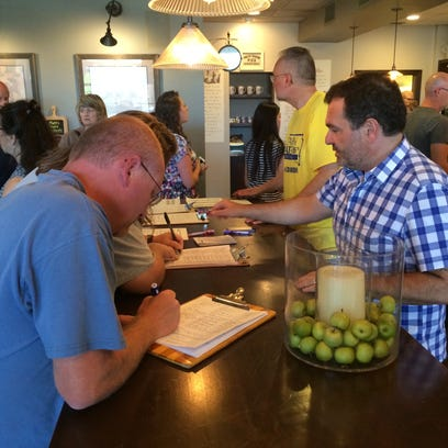 Customers sign petitions for South Dakotans for Responsible