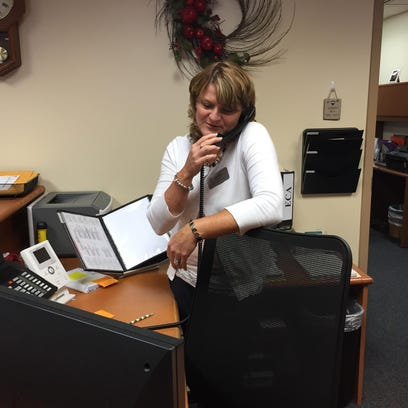 Principal Pam Barr answers the phone at Fairview Elementary