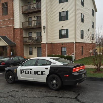 The scene outside Orchard Park Apartments, where police