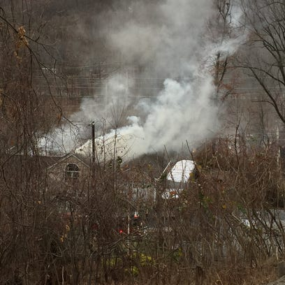 Heavy smoke billows from a house fire on Chestnut Hill