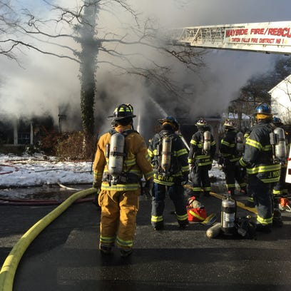 Firefighters battle a house blaze in Tinton Falls.