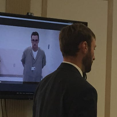Michael Medici, 29, of Dover appears via video feed