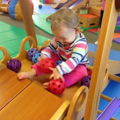 Isabella liked rolling the balls down at other kids.