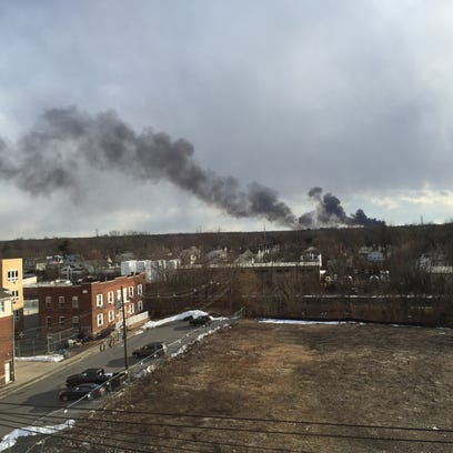 Smoke can be seen from Somerville.