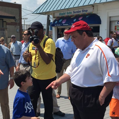 Gov. Chris Christie stops to chat with a boy on the