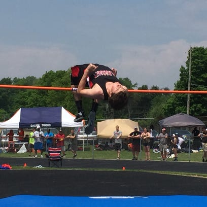 Pleasant sophomore Jed Charpie completes the jump at