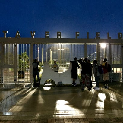 Fans wait outside Staver Field during a lightning delay