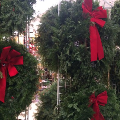 Christmas wreaths set up in the Rapids Mall will help
