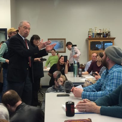 U.S. Sen. Chuck Grassley, left, holds a town hall in