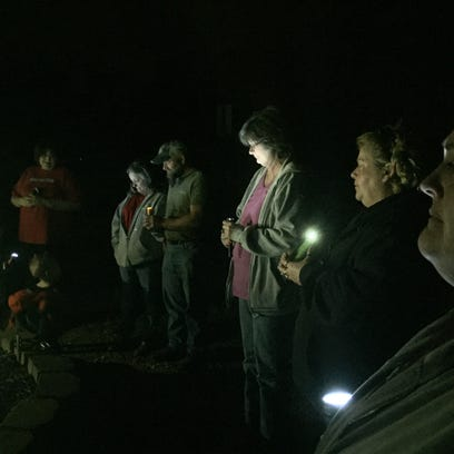 Family and friends of Curtis Henke hold a vigil Friday