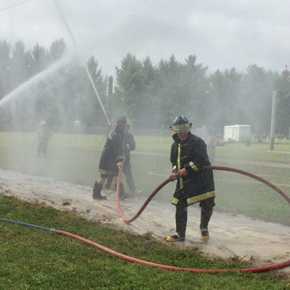 Firefights compete during the State Water Fight Championship