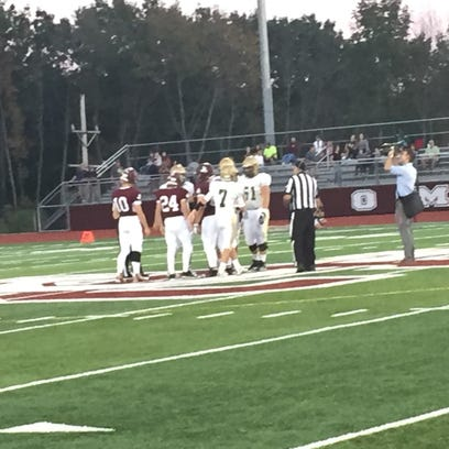 The captains for Vestal and Johnson City meet at midfield