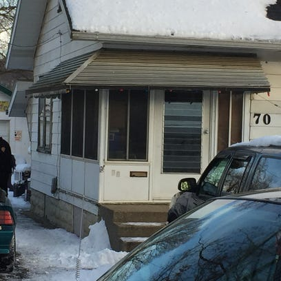 Newark Police search for evidence outside 70 Cottage