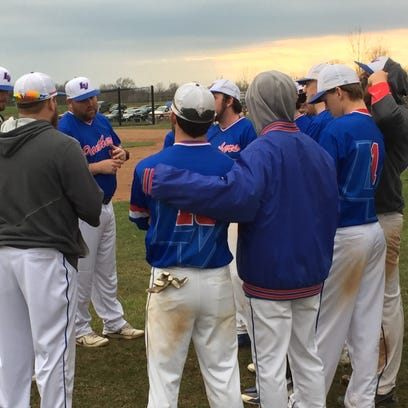 Licking Valley coach Adam Arcuri talks to his team