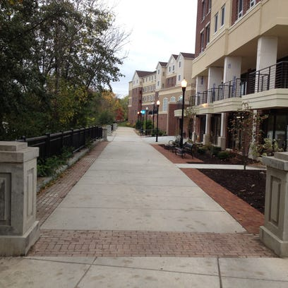 The newly opened Brooks Crossing fronts a walkway (looking south) that extends along Staybridge Suites at Brooks Landing and overlooks the Genesee River in southwest Rochester.