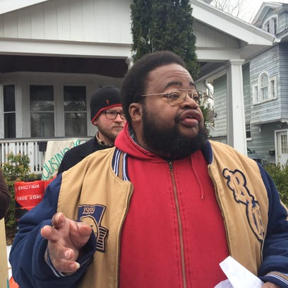 George Douglass protests eviction outside his home