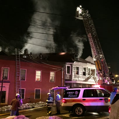 Firefighters battle a blaze on South Division Street