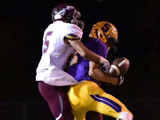 Smyrna's Percy Whittaker hauls in a catch during Friday's