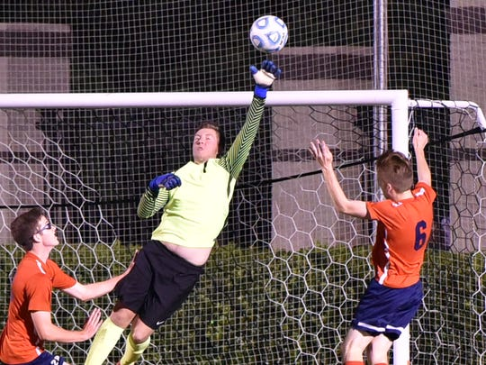 Blackman keeper Colin Dunkley makes a save during Thursday's 7-AAA finals.