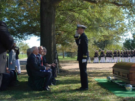 Navy Chaplain Lieutenant Clay C Edinger conducted funeral