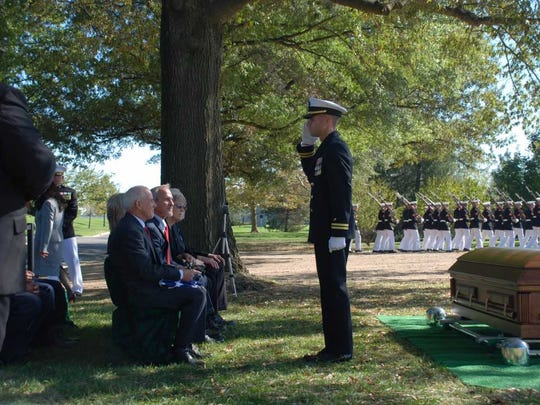 Navy Chaplain Lieutenant Clay C Edinger conducted funeral