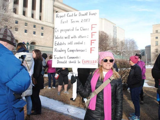 Gisela Terner of Fox Point, a college counselor and former teacher, gives President Donald Trump F's on his report card, suggesting he should be expelled on the sign she carried Saturday at the Women's March Wisconsin event in Milwaukee.