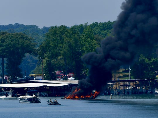 A boat on fire Monday, May 14, 2018, at the Portman
