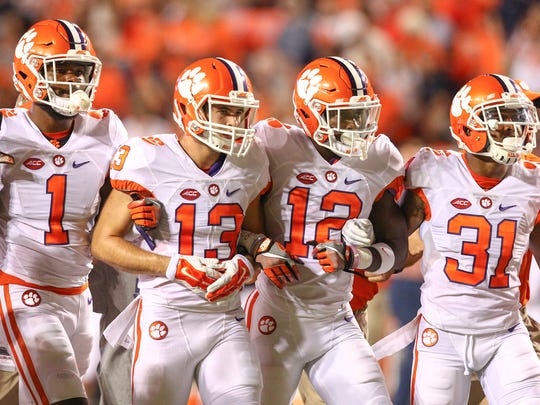 Clemson wide receiver Trayvon Mullen (1)(left), receiver Hunter Renfrow (13), defensive back K'Von Wallace (12), and cornerback Ryan Carter (31) walk with the team during pregame warmups at Jordan-Hare Stadium in Auburn, Alabama.