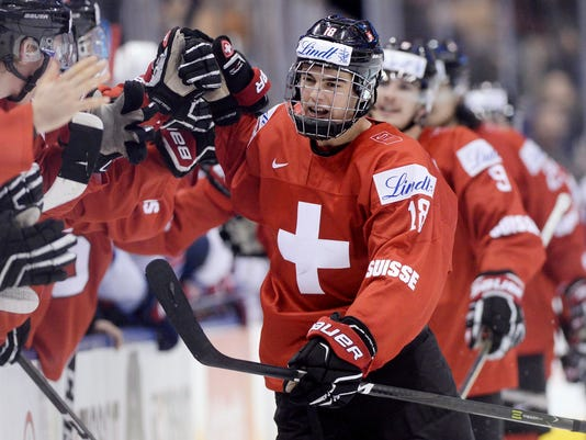 AP WORLD JUNIOR SWITZERLAND UNITED STATES HOCKEY S HKO CAN ON. Switzerland  forward Nico Hischier ... d38453f1d