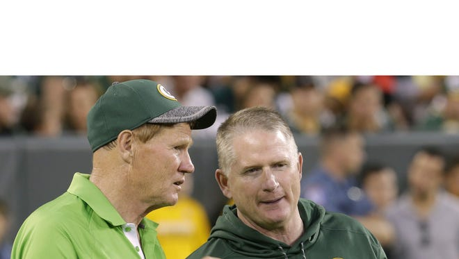 Green Bay Packers president Mark Murphy (left) talks with vice president of football administration/player finance Russ Ball during the team's 16th annual Family Night practice Sunday, July 31, 2016 at Lambeau Field in Green Bay.