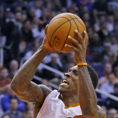Phoenix Suns guard Eric Bledsoe (2) runs over Chicago