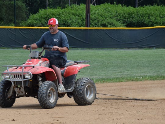 Volunteer Randy Yount drags the infield between games at the 13-year-old Babe Ruth League state tournament on Thursday, July 15, 2016, at Wilson Memorial High School's Bo Bowers Stadium in Fishersville.