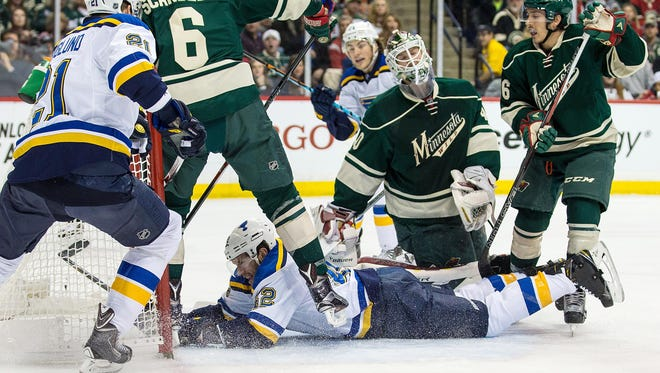 St. Louis Blues forward David Backes (42) scores a goal on Minnesota Wild goalie Devan Dubnyk (40) during the first period in game three of the first round of the 2015 Stanley Cup Playoffs at Xcel Energy Center.