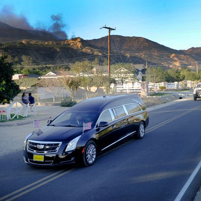 A hearse carries the body of a Cal Fire engineer Cory