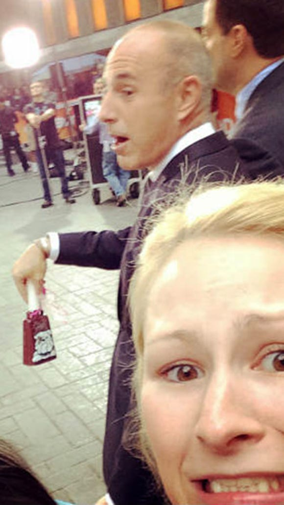 Anabel Wilson takes a selfie with Today Show host ringing her cowbell.