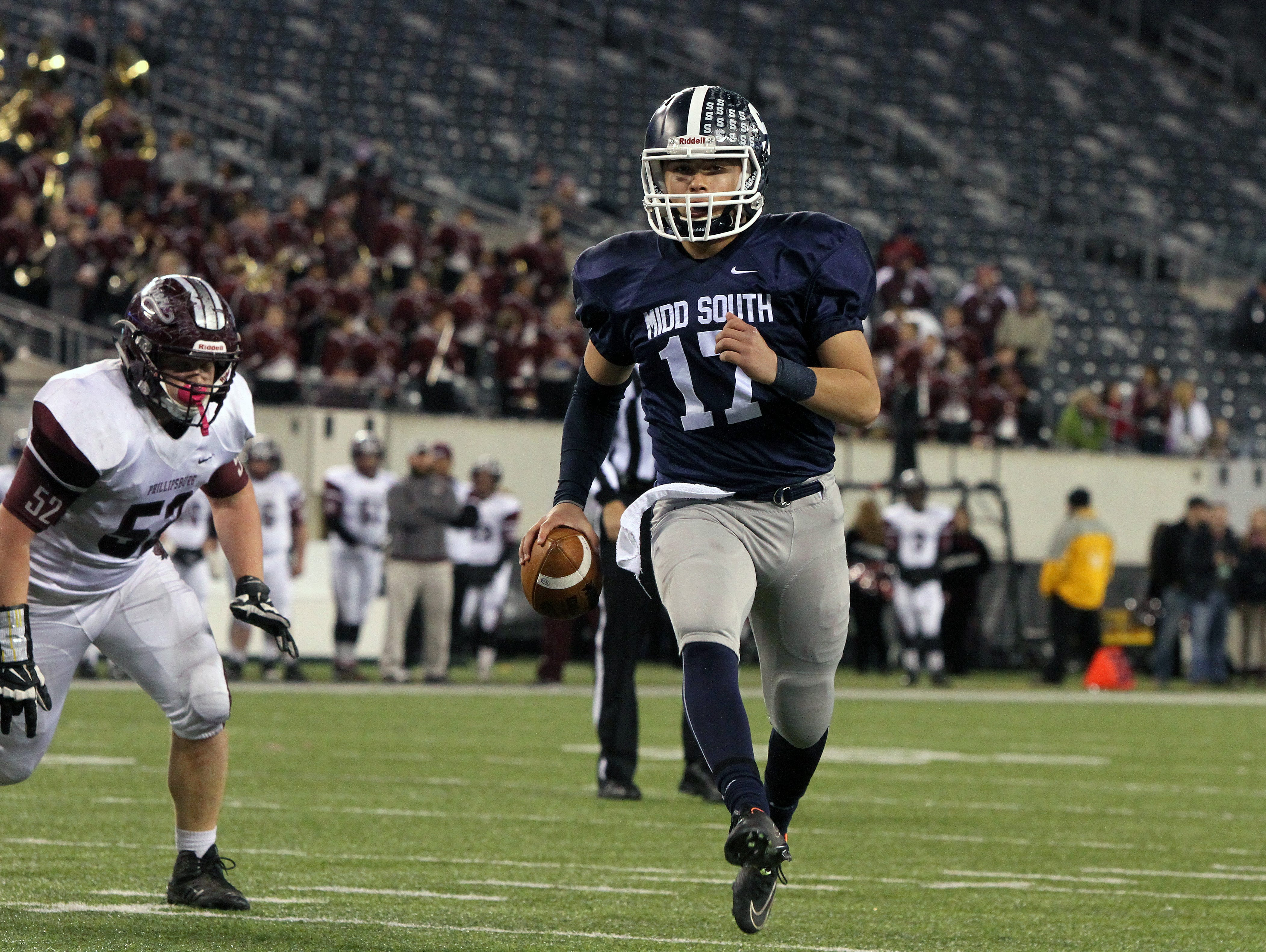 Middletown South's #17 Matt Mosquera runs the ball in for a touchdown during the second half against Phillipsburg High School during the North 2 Group IV game of the 2015 NJSIAA/MetLife Stadium High School Football Championships at MetLife Stadium in East Rutherford, NJ Saturday December 5, 2015.