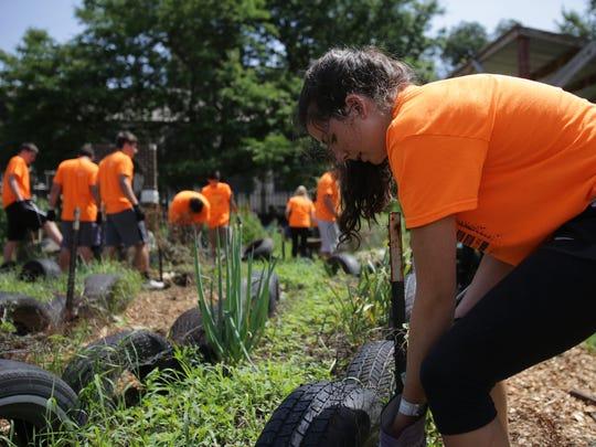 Savannah Kannapel, 18, of Des Moines volunteers to