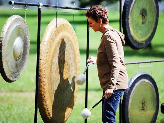 Carol Damoth of Royal Oak with Sacred Wave Gong Immersions performs a two hour outdoor healing gong concert.