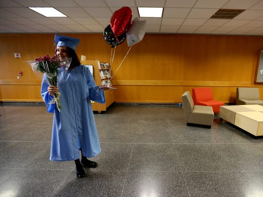 Calista Kountz, a South Salem High School graduating senior, gets ready to surprise her dad, Erick Kountz, at his work in Salem on Thursday, May 26, 2016. Calista thanked her dad for all his support through her school years.