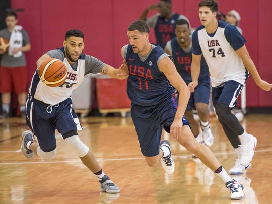 USA Select Team guard Denzel Valentine, left, competes for a basketball with Team USA guard Klay Thompson during practice in Las Vegas.