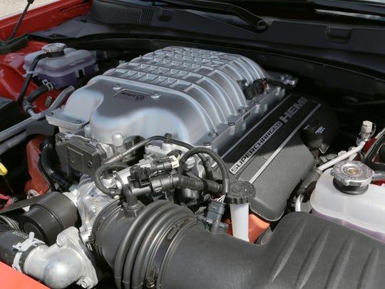 The 707-hp, HEMI V8 engine underneath the hood on a  2016 Dodge Charger SRT Hellcat.