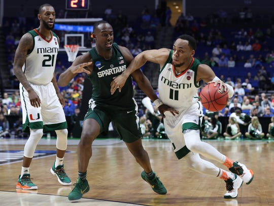 Miami guard Bruce Brown works around Michigan State guard Joshua Langford during the 2017 NCAA tournament.