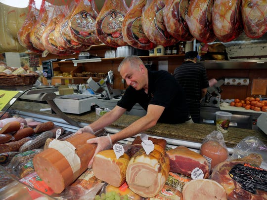 Sal Faenza, co-owner of Tuscany Specialty Foods and Catering, a 20-year old high-quality Italian market and caterer which has locations in Marlboro and Manalapan, showcases some of their meats at their location in Marlboro, NJ Monday, June 12, 2017.