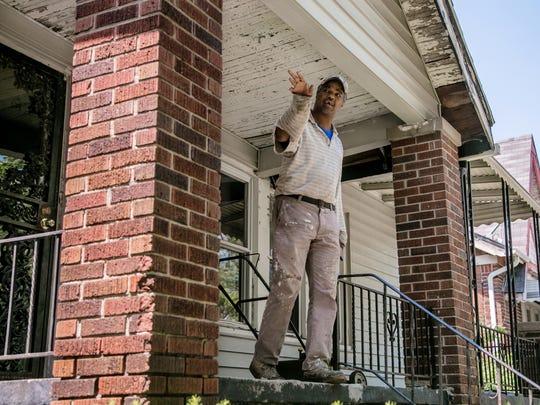 Maurice Gambrell talks on June 2 about his neighbor, Daniel Murray, who contends he was living in a home on Quincy in Detroit when it was torn down by the Detroit Land Bank Authority.