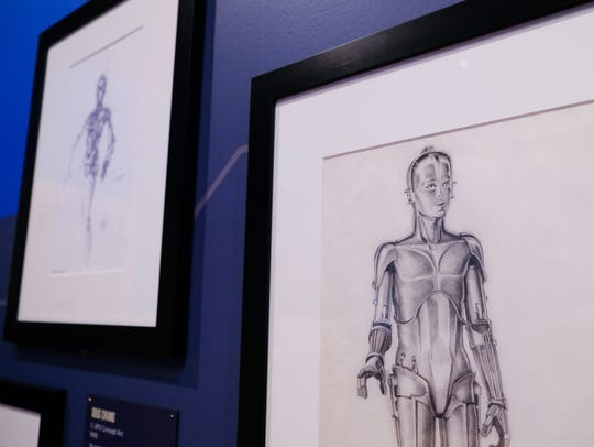 C-3PO concept art by Ralph McQuarrie from 1975 is seen