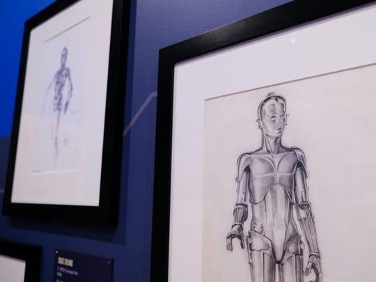 C-3PO concept art by Ralph McQuarrie from 1975 is seen during setup for the upcoming Star Wars and the Power of Costume exhibit at the Detroit Institute of Arts on Wednesday, May 9, 2018.